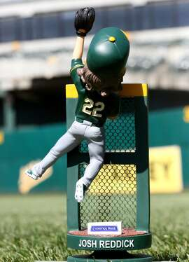 Josh Reddick bobblehead, depicting the A's right fielder climbing the wall to steal a home run. It'll be a giveaway at the Coliseum on May 28, 2016.