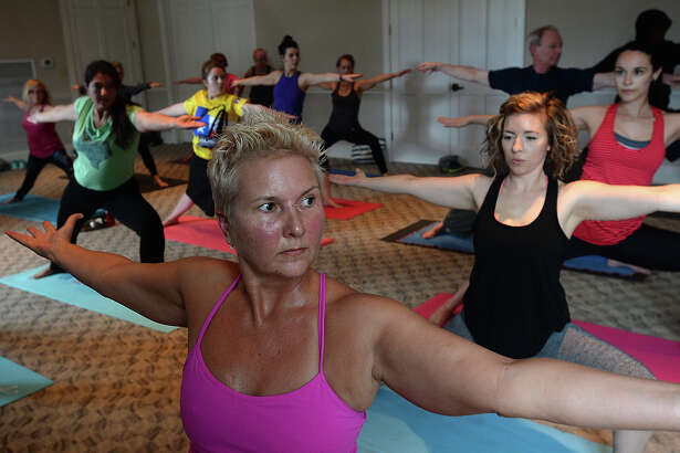 Sharissa LaHaye follows along through a series of yoga poses during the kick-off of Yoga Mondays at the Museum at the McFaddin-Ward House Visitor Center. Love Yoga led the event, which will run every last Monday of the month beginning in June. The events are scheduled to take place on the lawn at the house, weather permitting.  Photo taken Monday, May 2, 2016 Kim Brent/The Enterprise