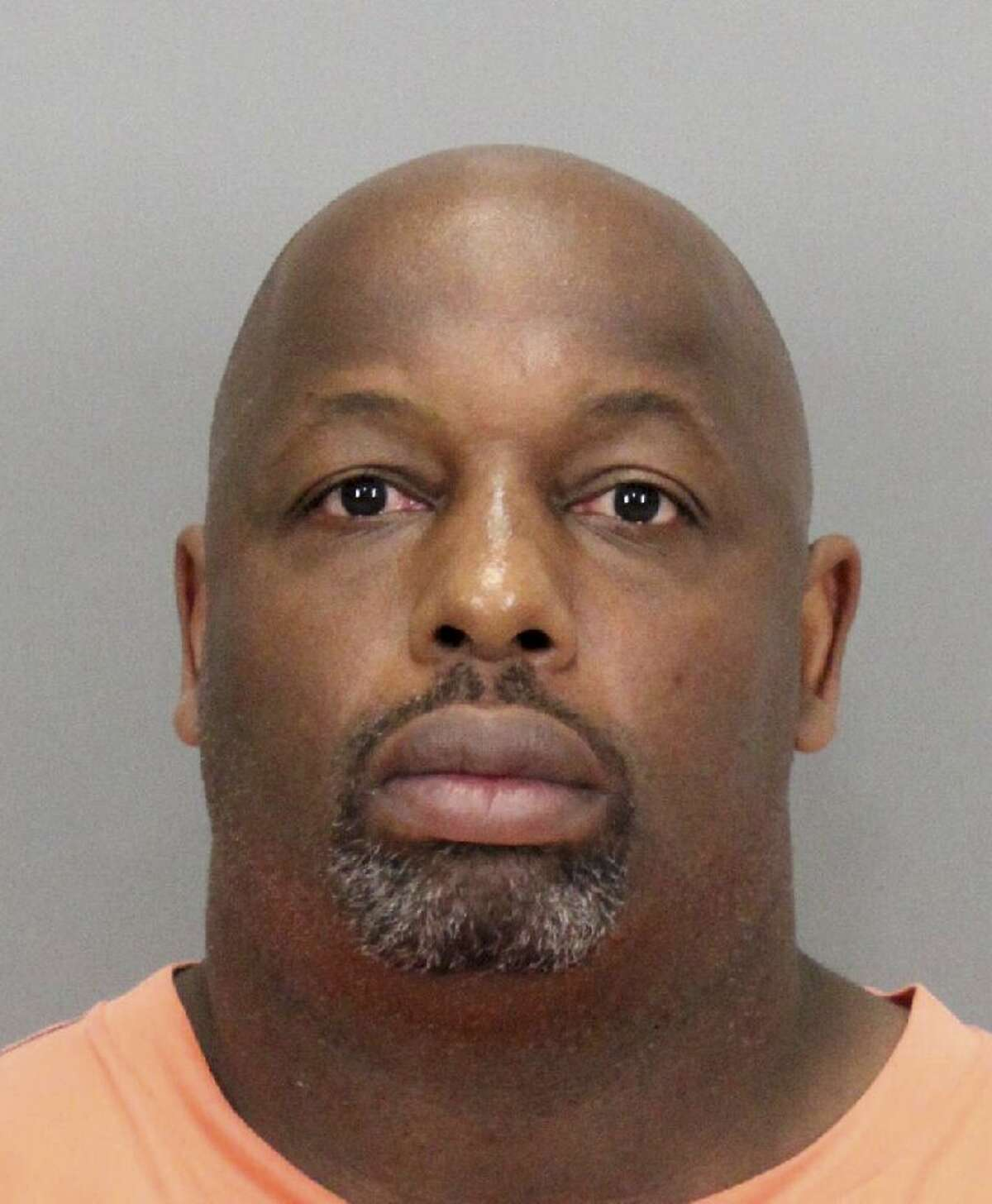 """In this undated booking photo released by the Santa Clara County District Attorney is former NFL football player Dana Stubblefield. Prosecutors say they have charged former San Francisco 49er Dana Stubblefield with the rape of a """"developmentally delayed"""" woman. The Santa Clara County District Attorney's Office says the 45-year-old Stubblefield was charged Monday, May 2, 2016, with sexually assaulting the woman last year at his Morgan Hill home. (Santa Clara County District Attorney via AP)"""