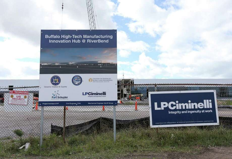 """In this Saturday, Oct. 17, 2015 photo, construction work continues at high-tech manufacturing site in Buffalo, N.Y. New York is committing $750 million to the factory for Elon Musk's SolarCity in exchange for a promise of 3,000 jobs and a $5 billion investment in manufacturing solar panels. It's a centerpiece of Gov. Andrew Cuomo's """"Buffalo Billion"""" campaign. But the plant is slated to be coming online as federal subsidies for solar installations begin to phase out.  (AP Photo/Mike Groll) Photo: Mike Groll / AP"""