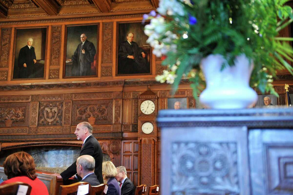 David Miranda, on left at podium, president of the New York State Bar Association, addresses those gathered for the annual Law Day on Monday, May 2, 2016, in Albany, N.Y. (Paul Buckowski / Times Union)