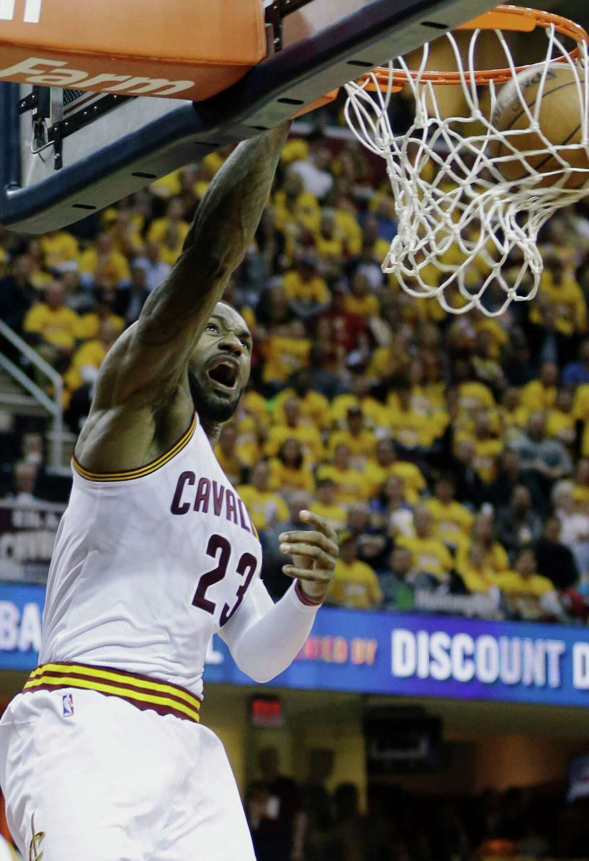 Cleveland Cavaliers' LeBron James (23) dunks against the Atlanta Hawks in the second half in Game 1 of a second-round NBA basketball playoff series, Monday, May 2, 2016, in Cleveland. (AP Photo/Tony Dejak) ORG XMIT: OHTD124