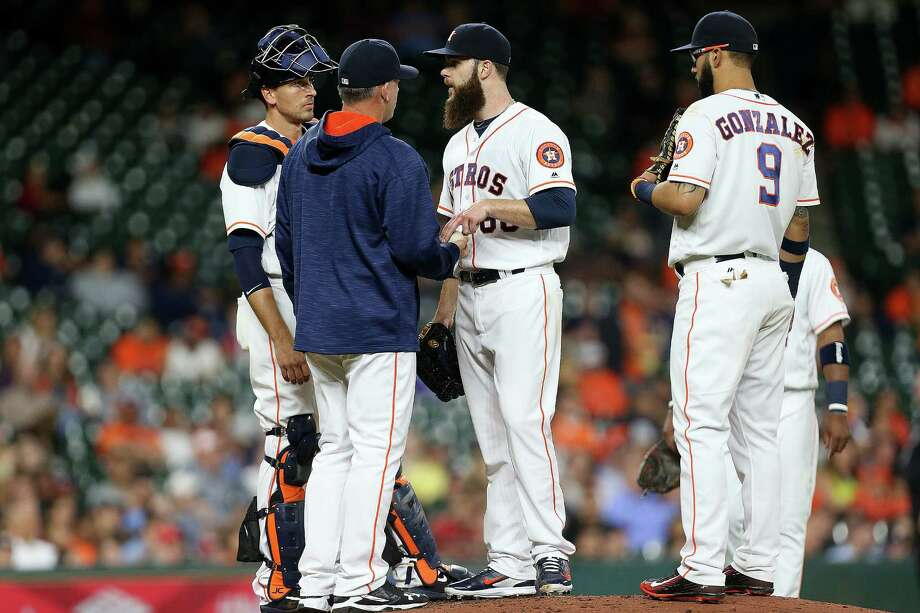 Houston Astros starting pitcher Dallas Keuchel (60) is taken off the mound by Houston Astros manager A.J. Hinch (14) in the top of the fifth inning. Photos of game one between Houston Astros and Minneapolis Twins at Minute Maid Park on   Monday, May 2, 2016, in Houston. Photo: Elizabeth Conley, Houston Chronicle / © 2016 Houston Chronicle