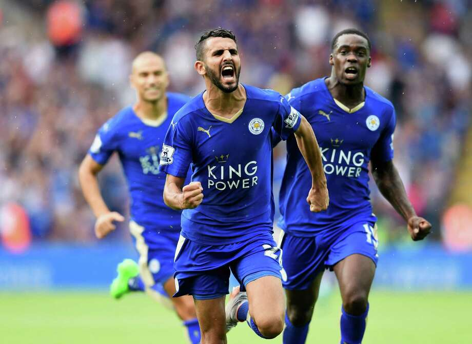 LEICESTER, ENGLAND - AUGUST 22:  Riyad Mahrez of Leicester City celebrates scoring his team's first goal  during the Barclays Premier League match between Leicester City and Tottenham Hotspur at The King Power Stadium on August 22, 2015 in Leicester, England.  (Photo by Michael Regan/Getty Images) Photo: Michael Regan, Staff / 2015 Getty Images