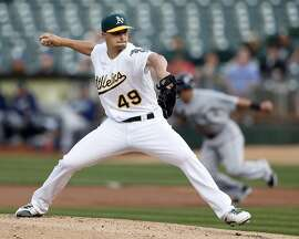 Oakland Athletics' Kendall Graveman delivers in 1st inning against Seattle Mariners during MLB game at Oakland Coliseum in Oakland, Calif., on Monday, May 2, 2016.