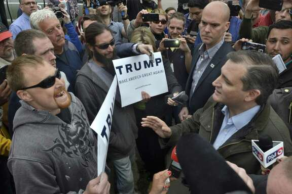 Republican presidential candidate Ted Cruz, right, exchanges words with Donald Trump supporters during a campaign visit to Marion, Ind., on Monday, May 2, 2016.  (Jeff Morehead/Chronicle-Tribune via AP)