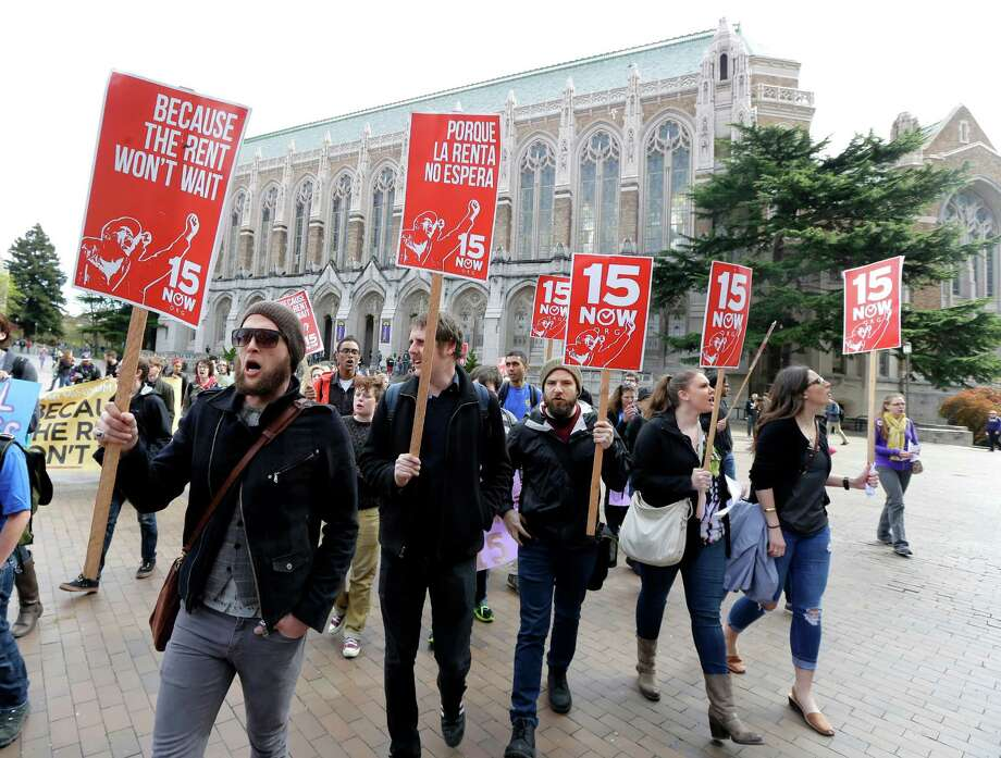 Protesters on the University of Washington campus in Seattle back higher wages for campus workers last year. The U.S. Supreme Court won't hear franchise owners' challenge to Seattle's minimum-wage law. Photo: Ted S. Warren, STF / Copyright 2016 The Associated Press. All rights reserved. This material may not be published, broadcast, rewritten or redistribu