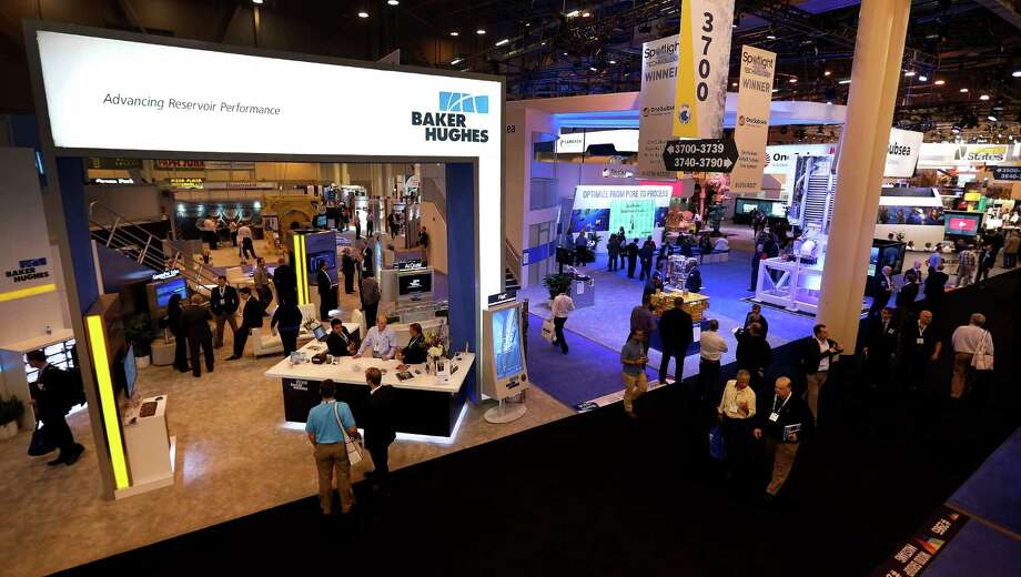 The Baker Hughes booth was busy Monday at the 2016 Offshore Technology Conference. So was Halliburton's.   Photo: Karen Warren, Staff / © 2016 Houston Chronicle