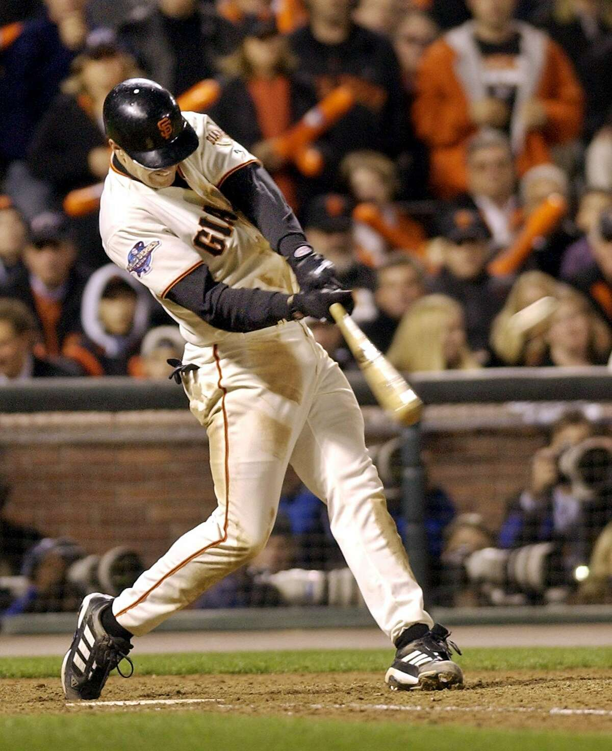 The San Francisco Giants' Jeff Kent connects for a two-run home run against the Anaheim Angels in the 6th inning of Game 5 of the World Series in San Francisco, Thursday, Oct. 24, 2002. (AP Photo/Kevork Djansezian)