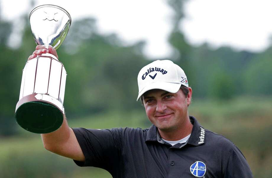 Brian Stuard holds up the tournament trophy after winning the PGA Zurich Classic golf tournament at TPC Louisiana in Avondale, La., Monday, May 2, 2016. The tournament was shortened to 54 holes due to lengthy rain delays all weekend. (AP Photo/Gerald Herbert) Photo: Gerald Herbert, STF / Copyright 2016 The Associated Press. All rights reserved. This material may not be published, broadcast, rewritten or redistribu