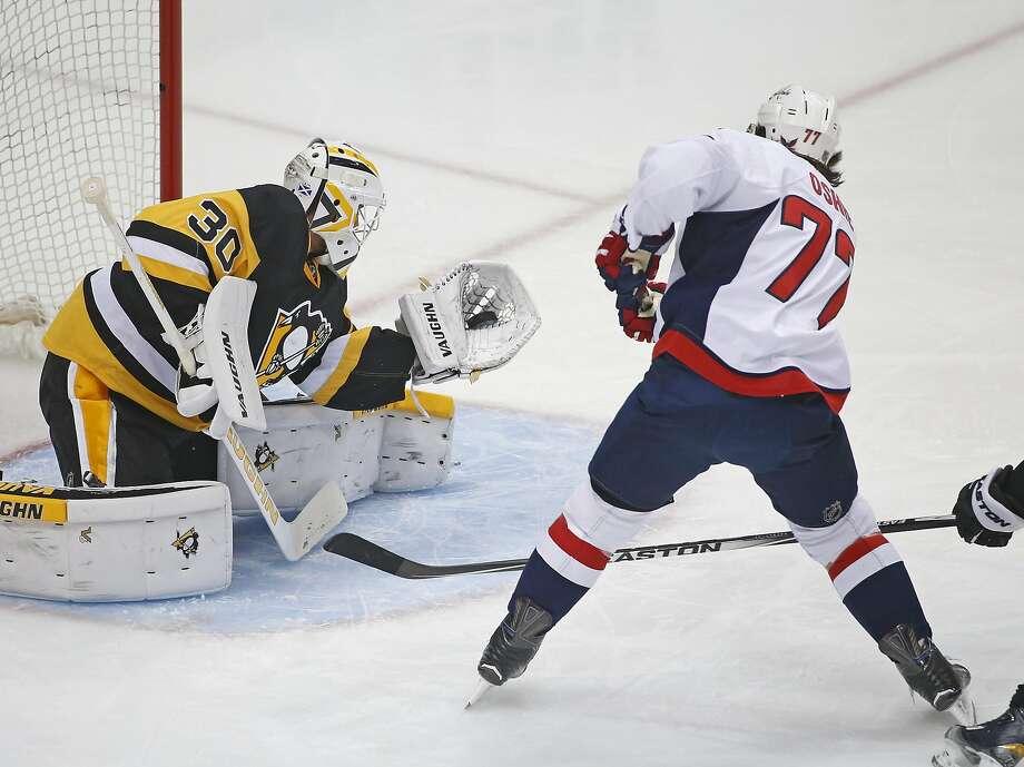 Pittsburgh Penguins goalie Matt Murray (30) makes a save against the Washington Capitals' T.J. Oshie in the first period. Photo: Gene J. Puskar, Associated Press