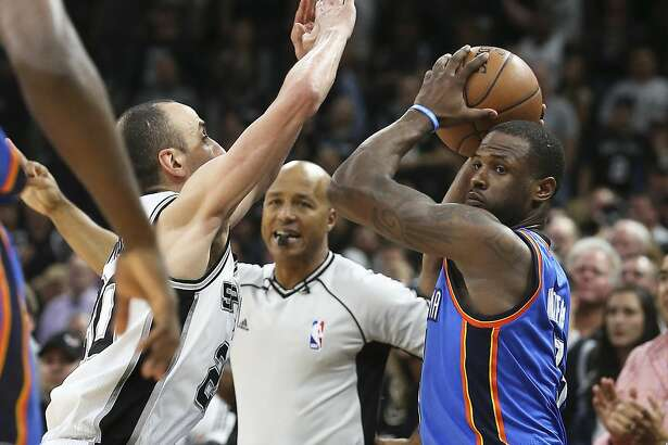 Manu Ginobili pressures Dion Waiters on the sideline with seconds left in the game as the Spurs host the Thunder in game 2 of second round NBA playoff action at the AT&T Center on May 2, 2016.  Waiters moments later pushed in on Ginobili and forced him back on the throw in.
