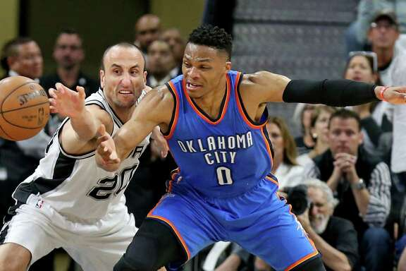 San Antonio Spurs' Manu Ginobili and Oklahoma City Thunder's Russell Westbrook grab for a loose ball during first half action of Game 2 in the Western Conference semifinals Monday May 2, 2016 at the AT&T Center.