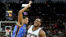 San Antonio Spurs' Kawhi Leonard drives around Oklahoma City Thunder's Andre Roberson during first half action of Game 2 in the Western Conference semifinals Monday May 2, 2016 at the AT&T Center.