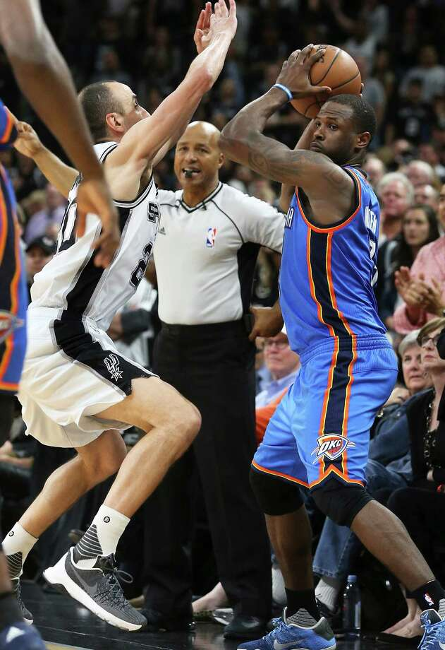 1.With 13.5 seconds to go in the game, the Spurs' Manu Ginobili pressures Oklahoma City's Dion Waiters on the sideline and appears to step out of bounds. No violation is called. Photo: Tom Reel /San Antonio Express-News / 2016 SAN ANTONIO EXPRESS-NEWS