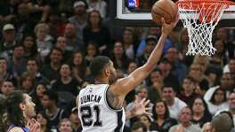 Tim Duncan puts up a shot at the hoop and misses in the first half as the Spurs host the Thunder in Game 2 of second round NBA playoff action at the AT&T Center on May 2, 2016.