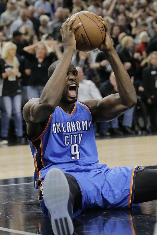 Thunder forward Serge Ibaka celebrates as time runs out on the Spurs' comeback. Photo: Eric Gay, Associated Press