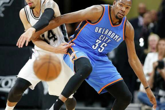 SAN ANTONIO,TX - MAY 2: Danny Green #14 of the San Antonio Spurs tries to steal the ball from Kevin Durant #35 of the Oklahoma City Thunder during game Two of the Western Conference Semifinals for the 2016 NBA Playoffs at AT&T Center on May 2, 2016 in San Antonio, Texas.  NOTE TO USER: User expressly acknowledges and agrees that , by downloading and or using this photograph, User is consenting to the terms and conditions of the Getty Images License Agreement.