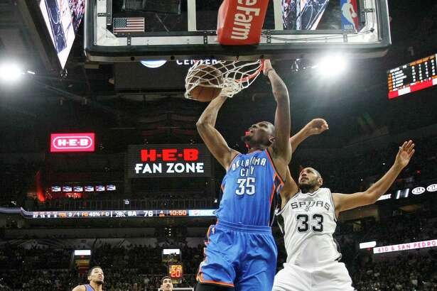 SAN ANTONIO,TX - MAY 2: Kevin Durant #35 of the Oklahoma City Thunder dunks in front of Boris Diaw #33 of the San Antonio Spurs during game Two of the Western Conference Semifinals for the 2016 NBA Playoffs at AT&T Center on May 2, 2016 in San Antonio, Texas.  NOTE TO USER: User expressly acknowledges and agrees that , by downloading and or using this photograph, User is consenting to the terms and conditions of the Getty Images License Agreement.