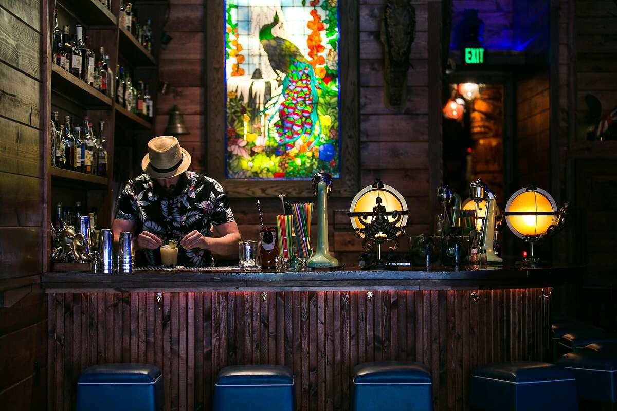 Daniel Parks makes a mai tai behind the bar at Pagan Idol in S. F.