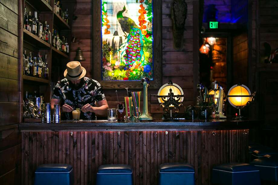 Daniel Parks makes a mai tai behind the bar at Pagan Idol in S.F. Photo: Jen Fedrizzi, Special To The Chronicle