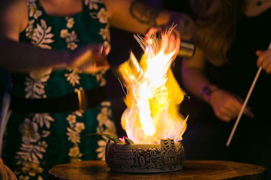 Tableside flames of Fassionola Gold at Pagan Idol in S.F. Photo: Jen Fedrizzi, Special To The Chronicle