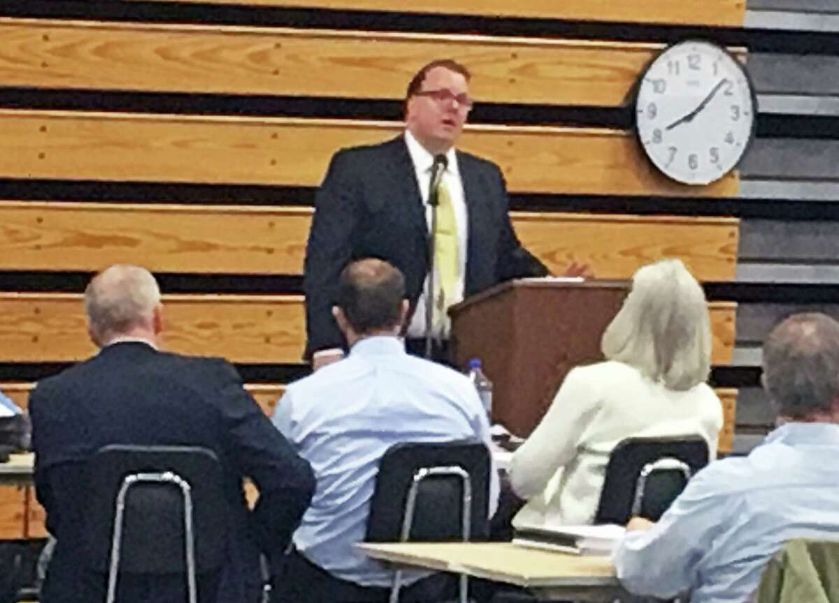 Representative Town Meeting member Michael Herley, R-10, urged the legislative body to adopt the town budget without any reductions.