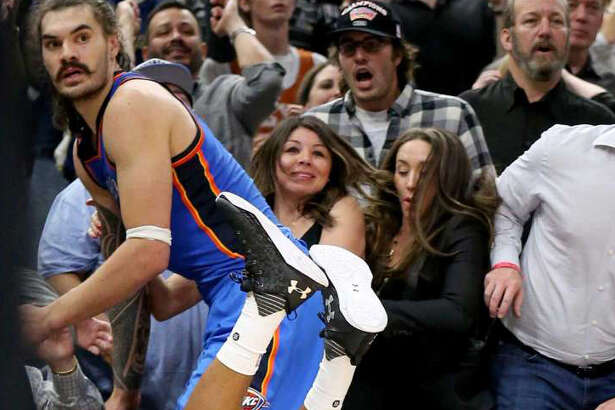 San Antonio Spurs' Patty Mills and Oklahoma City Thunder's Steven Adams watch Mills' 3-pointer jumper at the end of Game 2 in the Western Conference semifinals Monday May 2, 2016 at the AT&T Center. Mills missed the shot. The Thunder won 98-97.