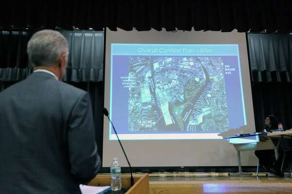 Attorney John Knuff speaks in front of the Stamford Planning Board during a meeting to review the Building and Land Technology's proposal to build housing, a boatyard and a marina on Southfield Avenue, the public meeting was held at Westover Magnet Elementary School, Stamford, Conn., Wednesday, Oct. 14, 2015. Knuff was representing Building and Land Technology.