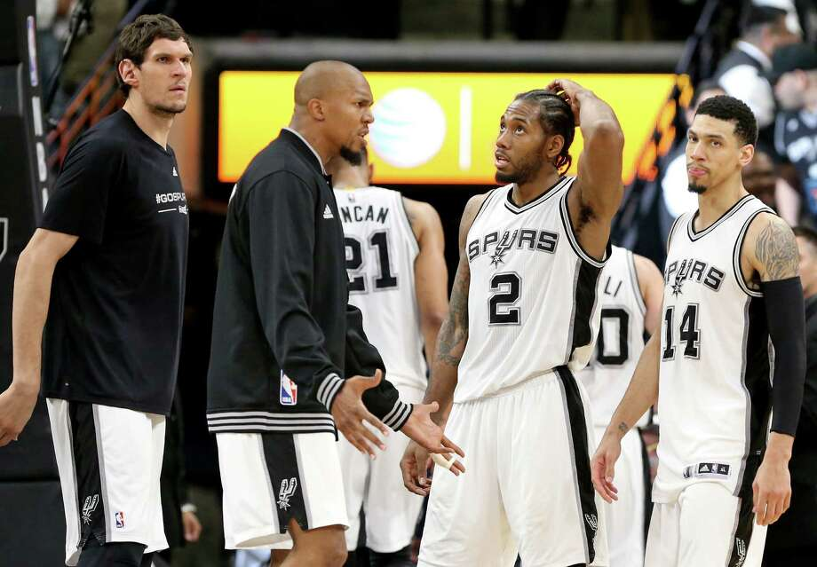 San Antonio Spurs' Boban Marjanovic (from left), David West, Kawhi Leonard, and Danny Green react after Game 2 in the Western Conference semifinals against the Oklahoma City Thunder Monday May 2, 2016 at the AT&T Center. The Thunder won 98-97. Photo: Edward A. Ornelas, Staff / San Antonio Express-News / © 2016 San Antonio Express-News
