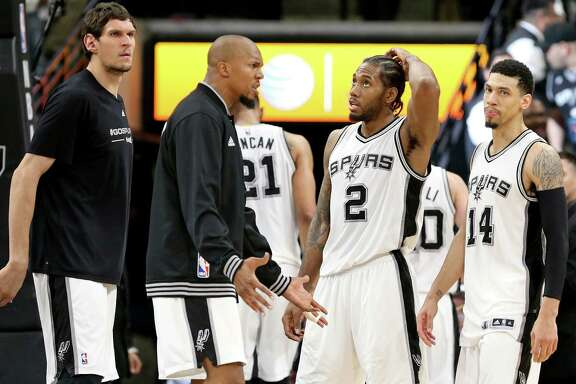 San Antonio Spurs' Boban Marjanovic (from left), David West, Kawhi Leonard, and Danny Green react after Game 2 in the Western Conference semifinals against the Oklahoma City Thunder Monday May 2, 2016 at the AT&T Center. The Thunder won 98-97.