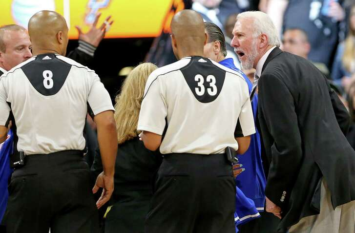 Spurs head coach Gregg Popovich complains to officials Marc Davis (left) and Sean Corbin after Game 2 in the Western Conference semifinals against the Oklahoma City Thunder on May 2, 2016 at the AT&T Center. The Thunder won 98-97.