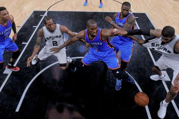 Oklahoma City's Russell Westbrook (from left), Spurs' Kawhi Leonard, Oklahoma City's Serge Ibaka and Dion Waiters and Spurs' LaMarcus Aldridge chase after a loose ball on the final play of Game 2 in the Western Conference semifinals on May 2, 2016 at the AT&T Center. The Thunder won 98-97.