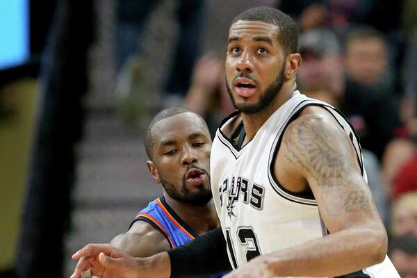Spurs' LaMarcus Aldridge looks for room around Oklahoma City Thunder's Serge Ibaka during second half action of Game 2 in the Western Conference semifinals on May 2, 2016 at the AT&T Center.