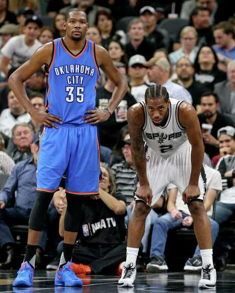 Oklahoma City Thunder's Kevin Durant and San Antonio Spurs' Kawhi Leonard pause during second half action of Game 2 in the Western Conference semifinals Monday May 2, 2016 at the AT&T Center. The Thunder won 98-97. Photo: Edward A. Ornelas, Staff / San Antonio Express-News / © 2016 San Antonio Express-News