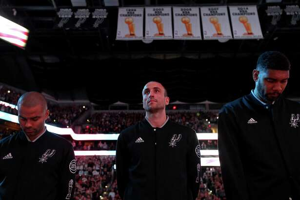 San Antonio Spurs' Tony Parker (from left), Manu Ginobili, and Tim Duncan stand during the national anthem before Game 2 in the Western Conference semifinals against the Oklahoma City Thunder on May 2, 2016 at the AT&T Center.