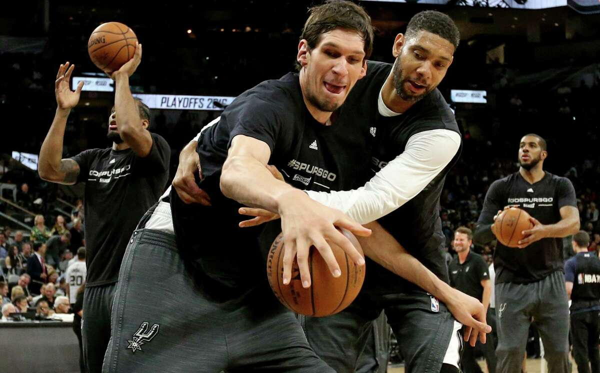 Spurs' Boban Marjanovic and Tim Duncan warm up before Game 2 in the Western Conference semifinals against the Oklahoma City Thunder on May 2, 2016 at the AT&T Center.