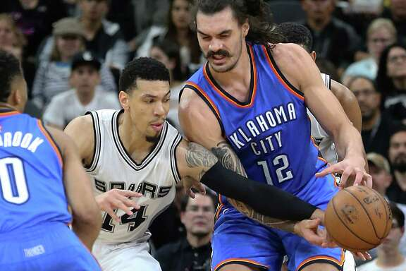Danny Green steals the ball from Steven Adams as the Spurs host the Thunder in Game 2 of second round NBA playoff action at the AT&T Center on May 2, 2016.