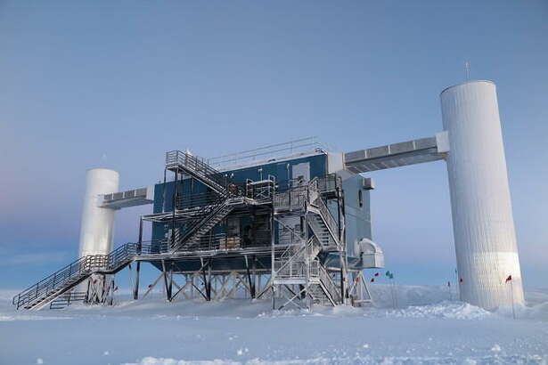 The IceCube Laboratory at the Amundsen-Scott South Pole Station, in Antarctica, hosts the computers that collect raw data from the detector. Due to satellite bandwidth allocations, the first level of reconstruction and event filtering happens in near real time in this lab. Only events selected as interesting for physics studies are sent to UW–Madison, where they are prepared for use by any member of the IceCube Collaboration.