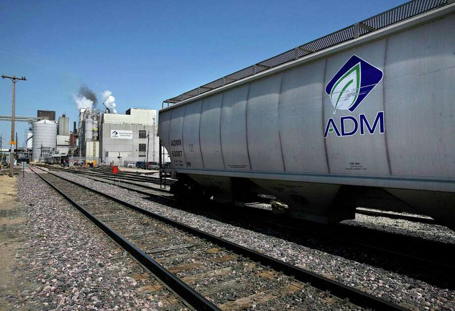 ADM buys and stores agriculture commodities and processes crops such grain and oilseeds into food, livestock feed and fuel. Photo: Bloomberg News /File Photo