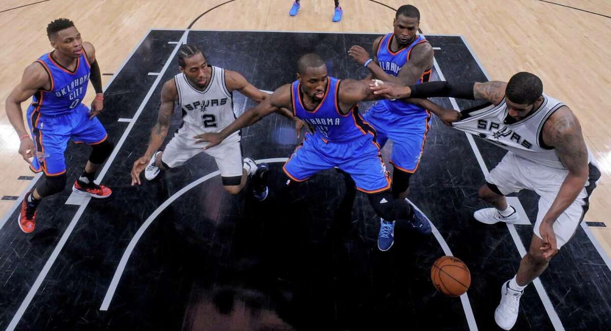 Oklahoma City Thunder's Russell Westbrook (from left), San Antonio Spurs' Kawhi Leonard, Oklahoma City Thunder's Serge Ibaka, Oklahoma City Thunder's Dion Waiters and San Antonio Spurs' LaMarcus Aldridge chase after a loose ball on the final play of Game 2 in the Western Conference semifinals Monday May 2, 2016 at the AT&T Center. The Thunder won 98-97.