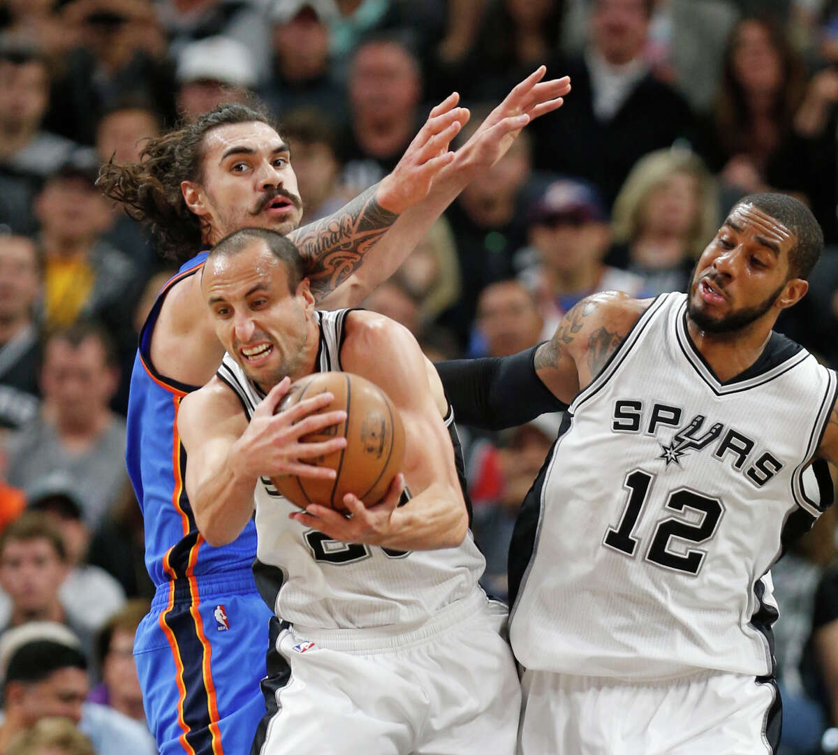 SAN ANTONIO,TX - MAY 2: Manu Ginobili #20 of the San Antonio Spurs grabs a rebound in front of Steven Adams #12 of the Oklahoma City Thunder during game Two of the Western Conference Semifinals for the 2016 NBA Playoffs at AT&T Center on May 2, 2016 in San Antonio, Texas. NOTE TO USER: User expressly acknowledges and agrees that , by downloading and or using this photograph, User is consenting to the terms and conditions of the Getty Images License Agreement. (Photo by Ronald Cortes/Getty Images)