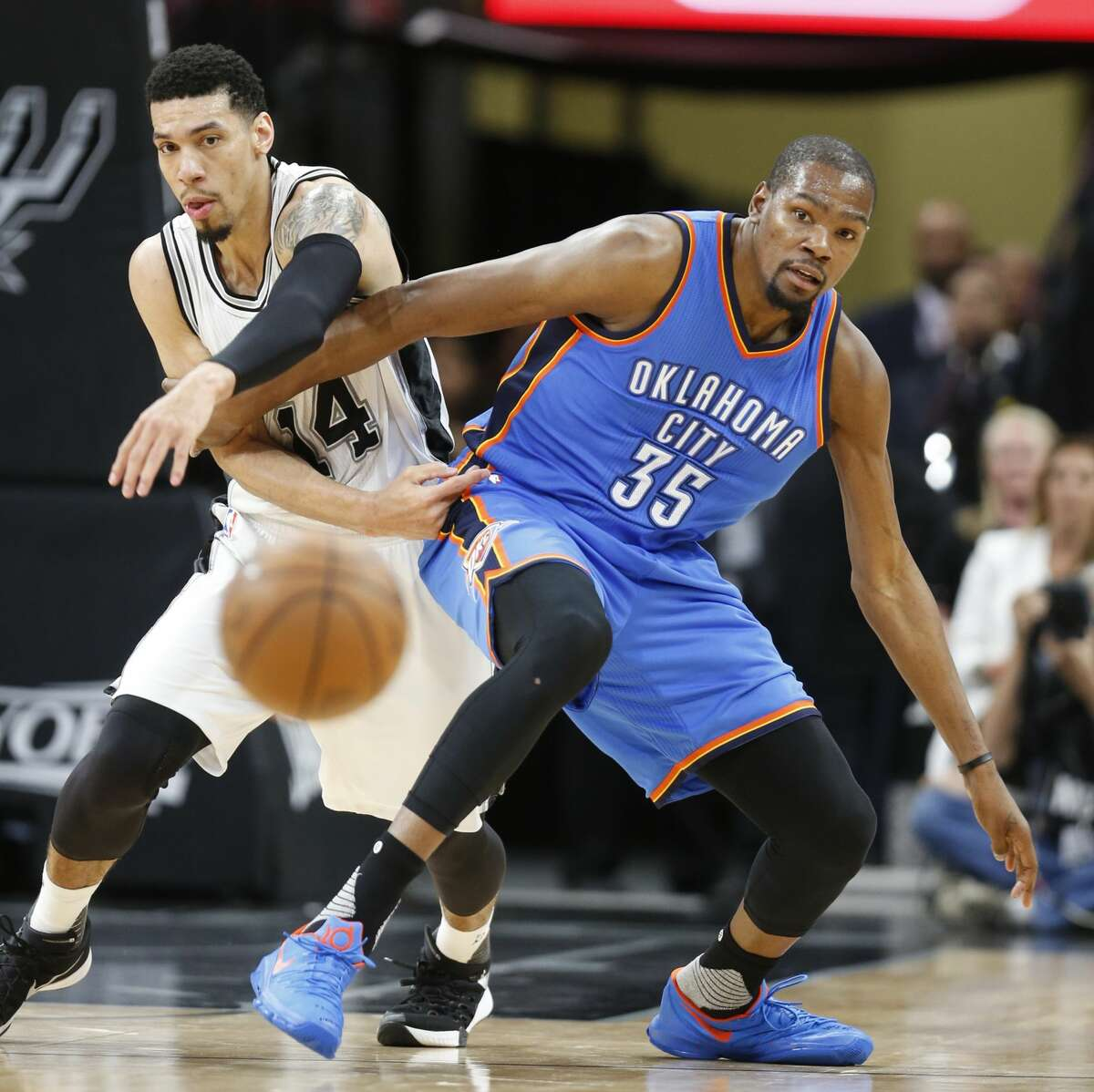 SAN ANTONIO,TX - MAY 2: Danny Green #14 of the San Antonio Spurs tries to steal the ball from Kevin Durant #35 of the Oklahoma City Thunder during game Two of the Western Conference Semifinals for the 2016 NBA Playoffs at AT&T Center on May 2, 2016 in San Antonio, Texas. NOTE TO USER: User expressly acknowledges and agrees that , by downloading and or using this photograph, User is consenting to the terms and conditions of the Getty Images License Agreement. (Photo by Ronald Cortes/Getty Images)