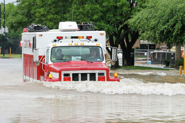 A city of Katy rescue vehicle pushes a wake of flood water just before stalling on Avenue D and having to be towed on April 18. Such problems have prompted Katy Office of Emergency Management coordinator Maria Galvez to call for buying more high-water vehicles and boats for flood response. The city's fire station is at 1417 Ave. D.  A city of Katy rescue vehicle pushes a wake of flood water just before stalling on Avenue D and having to be towed on April 18. Such problems have prompted Katy Office of Emergency Management coordinator Maria Galvez to call for buying more high-water vehicles and boats for flood response. The city's fire station is at 1417 Ave. D.