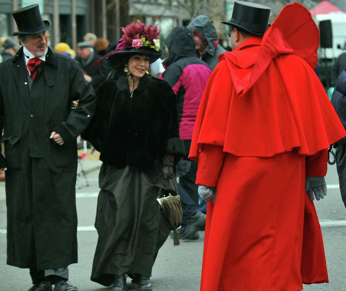 Frank and Maria Hadley of Long Valley, NJ, greet Troy Mayor Harry Tutunjian, right, during the 28th annual Victorian Stroll in Troy, NY on Sunday December 5, 2010. ( Philip Kamrass / Times Union )