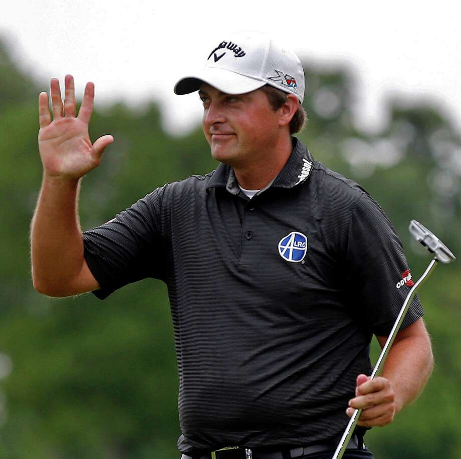 Brian Stuard waves after sinking his putt on the 18th green during a playoff round to win the rain-delayed Zurich Classic golf tournament at TPC Louisiana in Avondale, La., Monday, May 2, 2016.  (AP Photo/Gerald Herbert) ORG XMIT: LAGH105 Photo: Gerald Herbert / Copyright 2016 The Associated Press. All rights reserved. This m