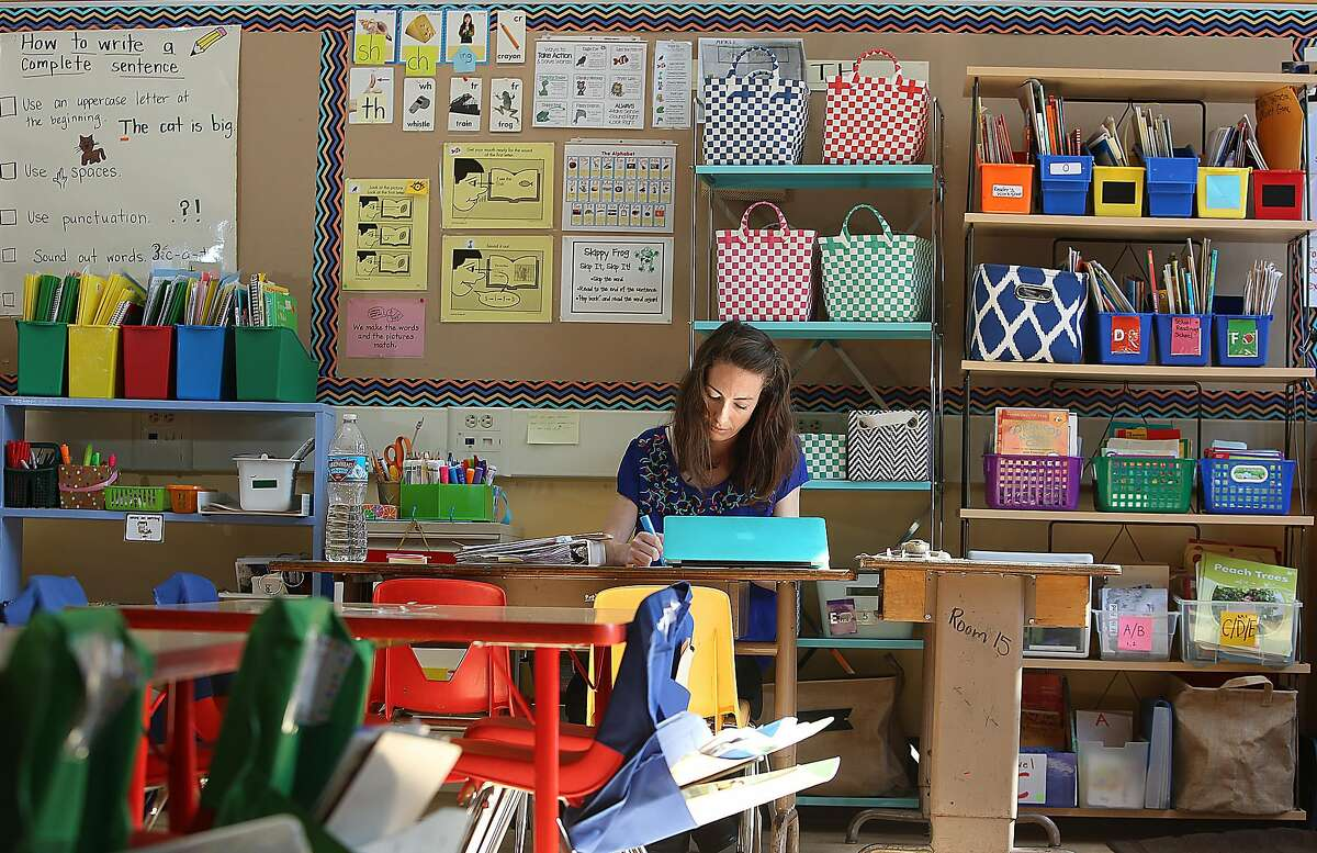 Cesar Chavez elementary school teacher Rebecca Sheehad-Stross prepares for tomorrow after school in San Francisco, California on monday, may 2, 2016.