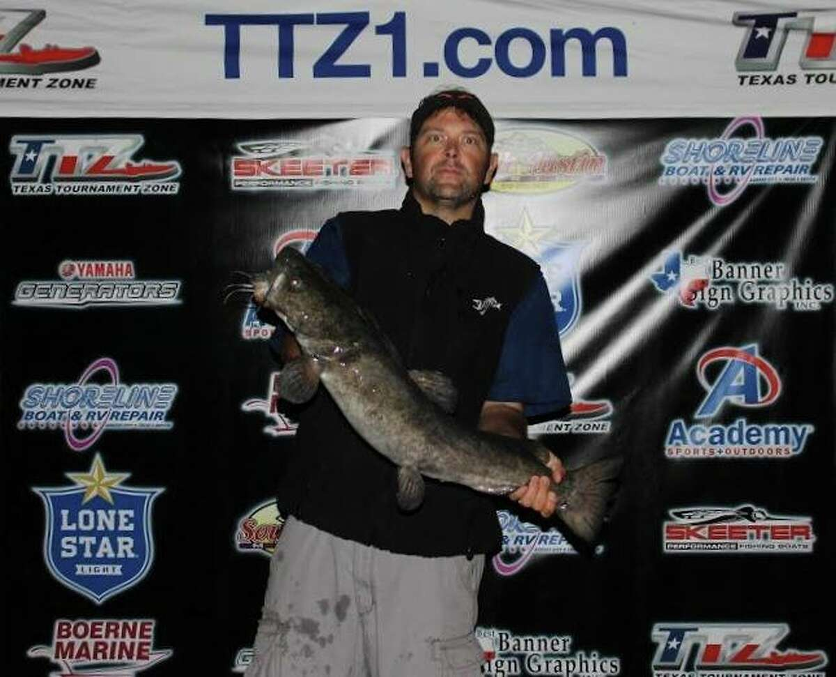 John Ward, a Texas Tournament Zone competitive bass fisher, reeled in a potentially record-breaking flathead catfish out of Lake Austin in late April.