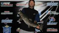 Man enters bass tournament, reels in potentially record-breaking catfish for Lake Austin - Photo