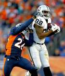 Oakland Raiders tight end Clive Walford (88) makes a catch as Denver Broncos free safety Darian Stewart (26) defends during the second half of an NFL football game, Sunday, Dec. 13, 2015, in Denver. (AP Photo/Joe Mahoney)